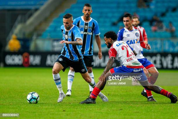 Luan of Gremio battles for the ball against Rene Junior of Bahia during the match between Gremio and Bahia as part of Brasileirao Series A 2017 at...