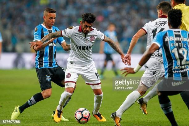 NOVEMBER 22 Luan of Gremio battles for the ball against Rolando Martinez of Lanus during the match between Gremio and Lanus part of Copa Bridgestone...