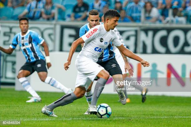 Luan of Gremio battles for the ball against Yuri of Santos during the match Gremio v Santos as part of Brasileirao Series A 2017 at Arena do Gremio...
