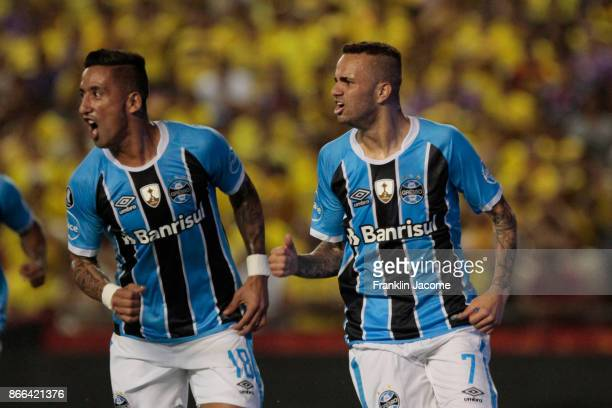 Luan of Gremio celebrates with temmate Lucas Barrios after scoring the opening goal during a first leg match between Barcelona SC and Gremio as part...