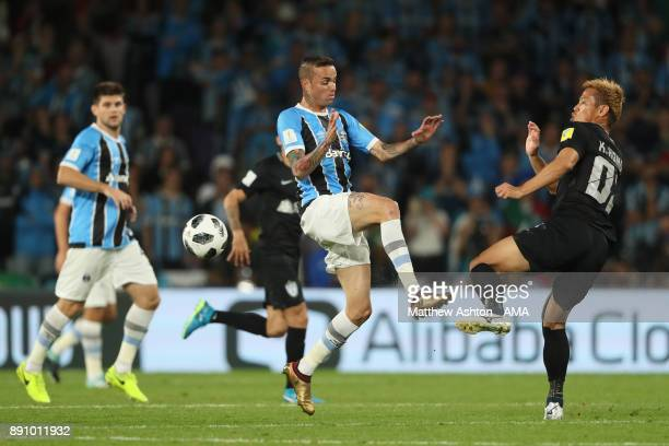 Luan of Gremio FBPA competes with Keisuke Honda of CF Pachuca during the FIFA Club World Cup UAE 2017 semifinal match between Gremio FBPA and CF...