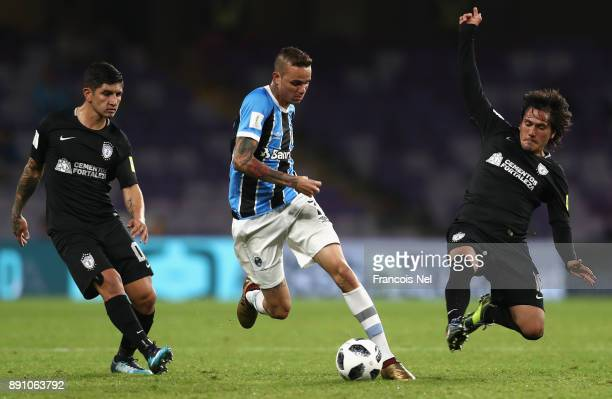 Luan of Gremio is challenged by Jorge Hernandez of CF Pachuca during the FIFA Club World Cup UAE 2017 semifinal match between Gremio FBPA and CF...