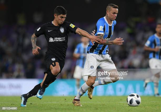 Luan of Gremio is challenged by Victor Guzman of CF Pachuca during the FIFA Club World Cup UAE 2017 semifinal match between Gremio FBPA and CF...