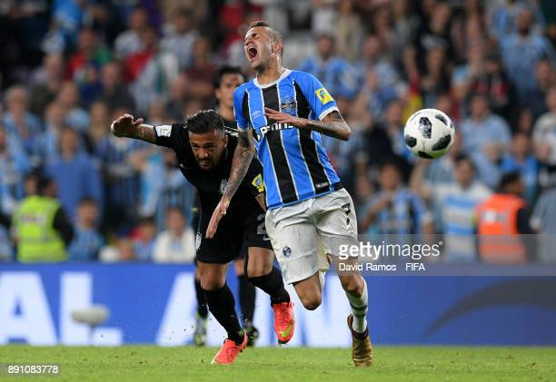 Luan of Gremio is tackled by Robert Herrera of CF Pachuca during the FIFA Club World Cup UAE 2017 semifinal match between Gremio FBPA and CF Pachuca...