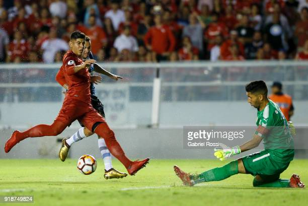 Luan of Gremio kicks the ball to socre the opening goal during the first leg match between Independiente and Gremio as part of CONMBEOL Recopa...