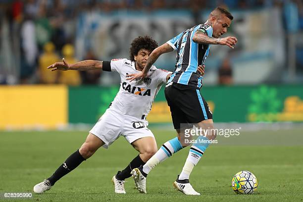 Luan of Gremio struggles for the ball with Luan of Atletico MG during a match between Gremio and Atletico MG as part of Copa do Brasil Final 2016 at...