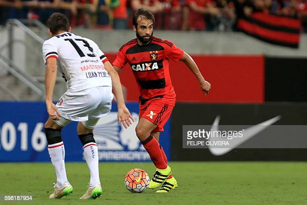 Luan Peres of Brazilian Santa Cruz vies for the ball with Gabriel Xavier of Brazilian Sport Recife during a Sudamericana Cup football match in Recife...