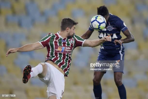 Luan Peres of Fluminense struggles for the ball with Bruno Henriqueof Santos during the match between Fluminense and Santos as part of Brasileirao...