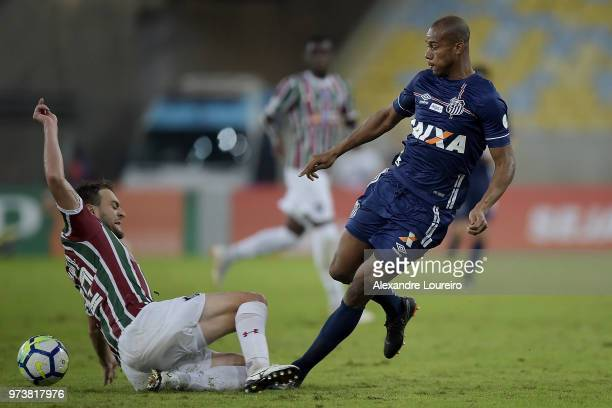 Luan Peres of Fluminense struggles for the ball with Copete of Santos during the match between Fluminense and Santos as part of Brasileirao Series A...