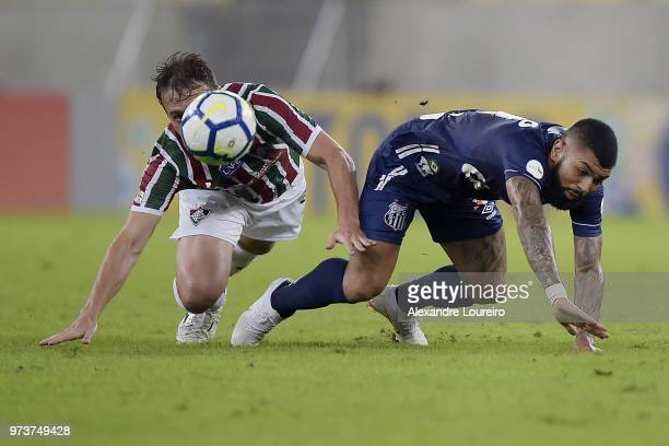 Luan Peres of Fluminense struggles for the ball with Gabriel Barbosa of Santos during the match between Fluminense and Santos as part of Brasileirao...
