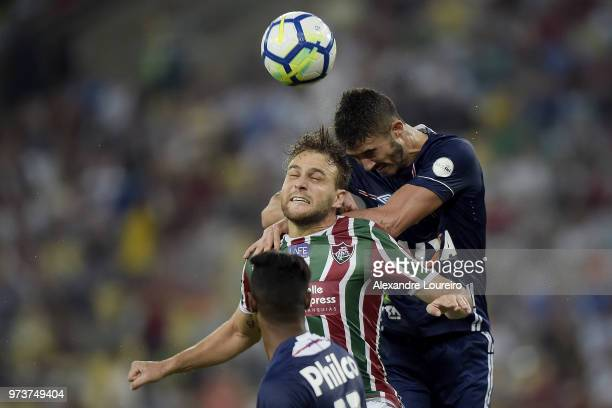 Luan Peres of Fluminense struggles for the ball with Gustavo Henrique of Santos during the match between Fluminense and Santos as part of Brasileirao...