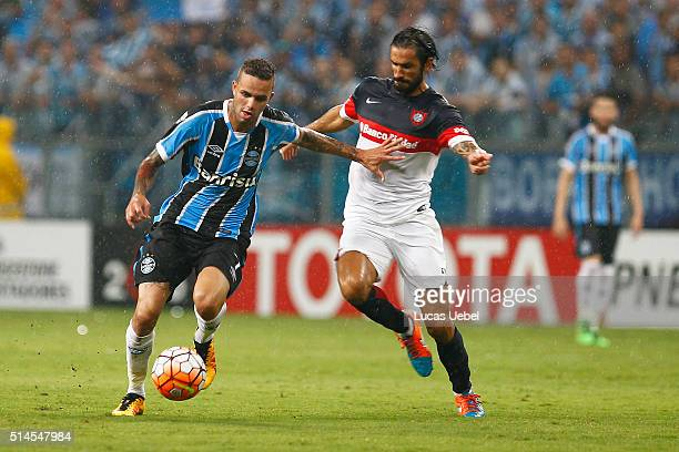 Luan player of Gremio battles for the ball against Matias Caruzzo during the match Gremio v San Lorenzo as part of Copa Bridgestone Libertadores 2016...