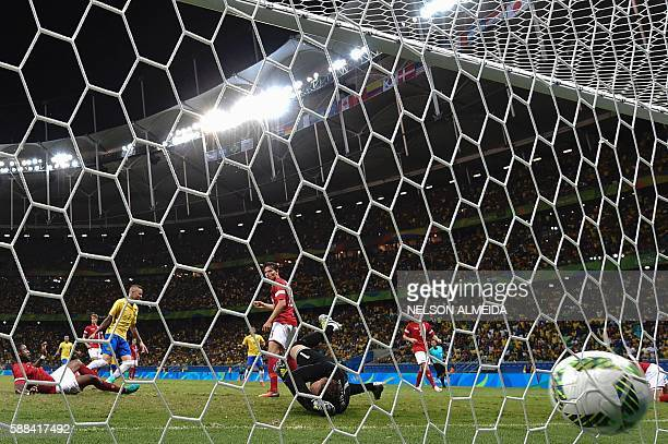 Luan Vieira of Brazil kicks to score against Denmark during the Rio 2016 Olympic Games mens first round Group A football match Brazil vs Denmark, at...