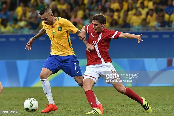 Luan Vieira of Brazil vies for the ball with Robert Skov of Denmark during the Rio 2016 Olympic Games mens first round Group A football match Brazil...