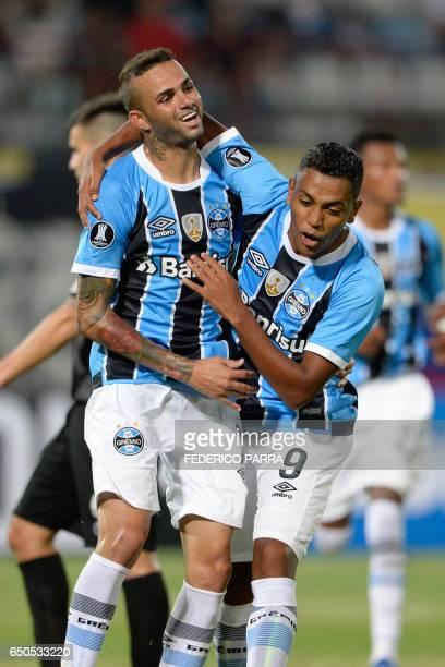 Luan Vieira of Brazil's Gremio, celebrates with teammates after scoring against Venezuela's Zamora, during their Copa Libertadores 2017 football...