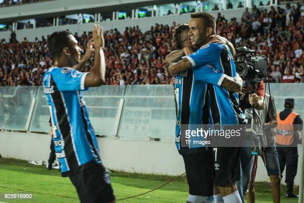 Luan Vieira of Gremio celebrates after scoring his team`s first goal with team mates during the first leg match between Independiente and Gremio as...