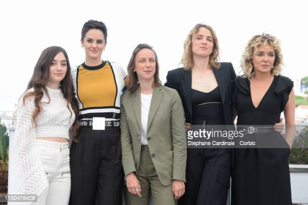 Luana Bajrami Noemie Merlant Celine Sciamma Adele Haenel and Valeria Golino attend the photocall for Portrait Of A Lady On Fire during the 72nd...