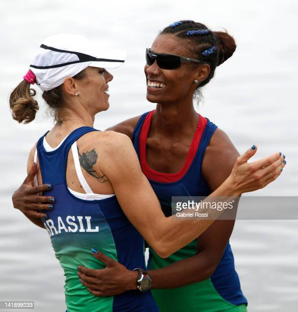 Luana Bartolo De Assis and Fabiana Beltrame of Brasil celebrate after qualifying for London 2012 during the women's Pair final during the Latin...