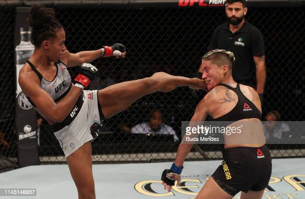 Luana Carolina of Brazil kicks Priscila Cachoeira of Brazil in their women's flyweight bout during the UFC 237 event at Jeunesse Arena on May 11,...