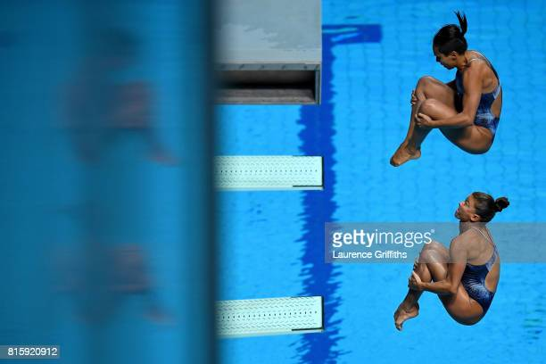 Luana Lira and Tammy Takagi of Brazil compete during the Women's Diving 3M Synchro Springboard preliminary round on day four of the Budapest 2017...