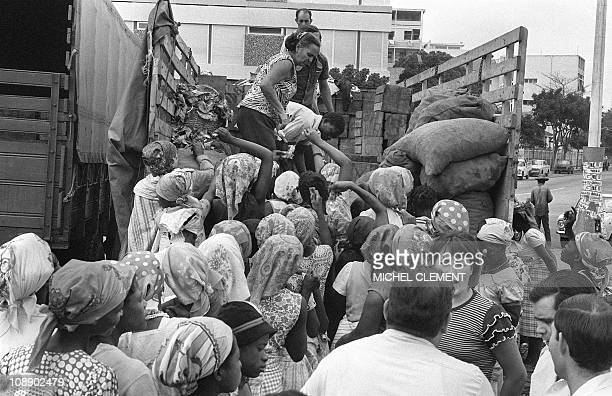 Luanda inhabitants buy food transported on a truck 04 September 1975 The Popular Movement for the Liberation of Angola announced the independence of...