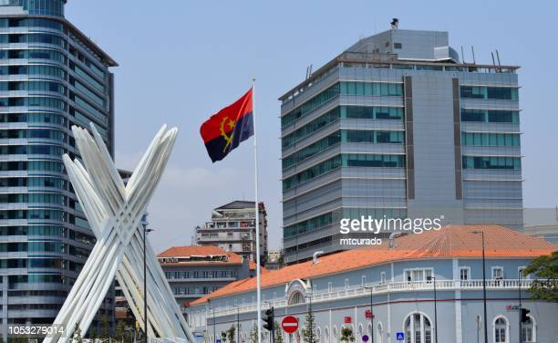 luanda - unknown soldier memorial in front of the central post office and flanked by two buildings of sonangol - waterfront avenue - angola - angola stock pictures, royalty-free photos & images