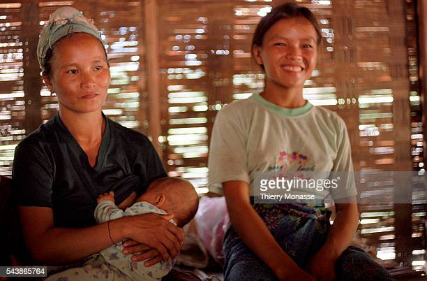 Luang Namtha Laos August 2003 A mother is Breastfeeding her baby