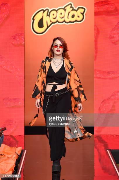 Luanna walks the runway as Cheetos unveiled faninspired versions of the #CheetosFlaminHaute look at The House Of Flamin' Haute Runway Show Style Bar...