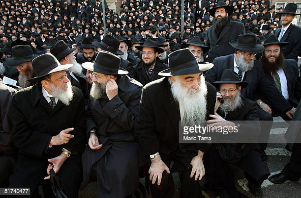Lubavitch rabbis clad in traditional Hassidic garb line up outside their worldwide headquarters for a photograph November 14 2004 in the Brooklyn...