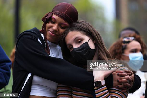 Lubianka Carrillo and Dorothy Maskara embrace during a vigil for Daunte Wright and Dominique Lucious at Washington Square Park in Manhattan on April...