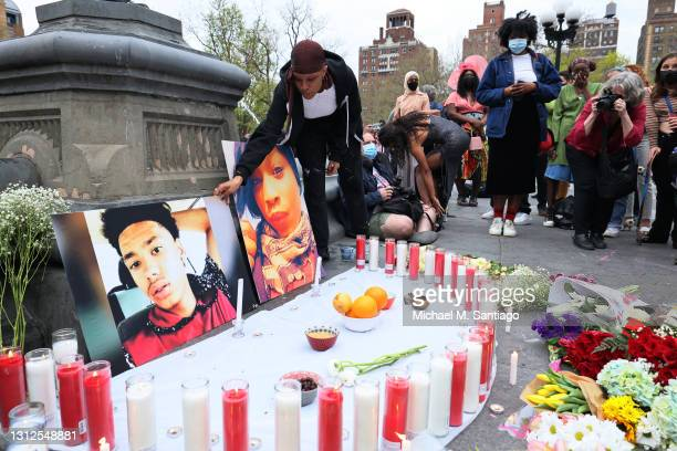 Lubianka Carrillo places photos in makeshift memorial during a vigil for Daunte Wright and Dominique Lucious at Washington Square Park in Manhattan...