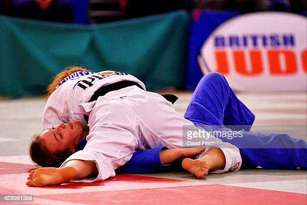 Lubjana Piovesana of Bishop Challoner JC throws and then holds Molly Game of Osaka JC to win their u63kg contest by an ippon during the 2016 British...