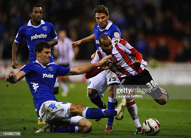 Lubomir Michalik of Portsmouth battles with Marcus Williams of Sheffield United during the npower League One match between Sheffield United and...