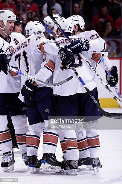 Lubomir Visnovsky and Shawn Horcoff of the Edmonton Oilers celebrate a goal against the Calgary Flames on October 17 2008 at Pengrowth Saddledome in...