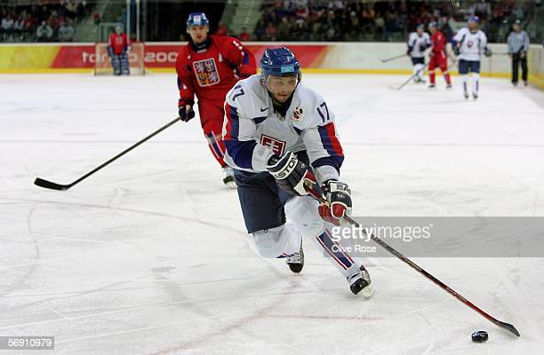 Lubomir Visnovsky of Slovakia controls the puck during the quarter final of the men's ice hockey match between Slovakia and Czech Republic during Day...