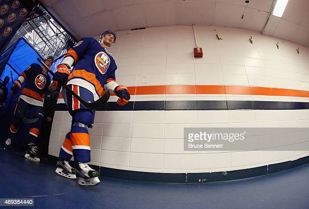 Lubomir Visnovsky of the New York Islanders returns to the locker room following the first period against the Columbus Blue Jackets at the Nassau...