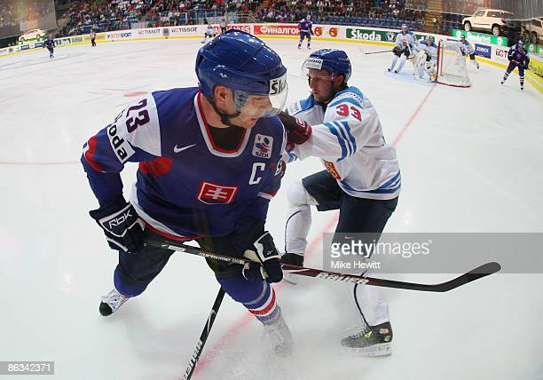 Lubos Bartecko of Slovakia is challenged by Mikko Lehtonen of Finland is challenged by during the IIHF World Championship match between Finland and...