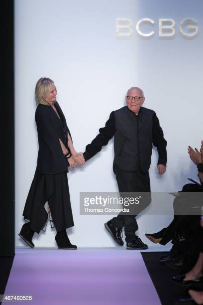 Lubov and Max Azria greet the audience after the BCBGMAXAZRIA fashion show during MercedesBenz Fashion Week Fall 2014 at The Theatre at Lincoln...