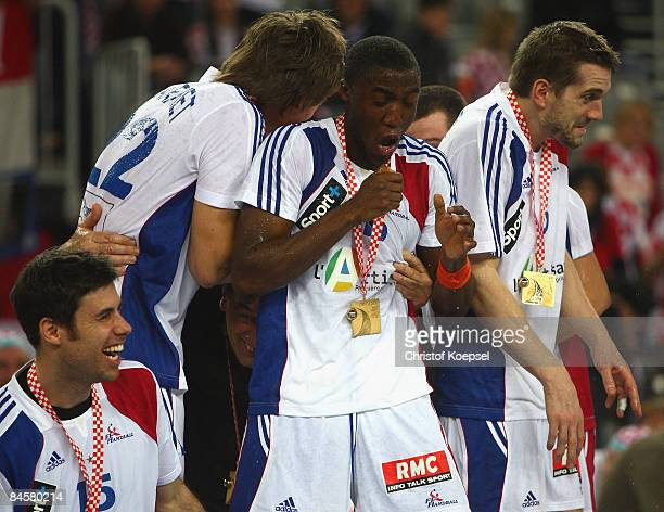 Luc Abalo of France got a load of champaign during the podium after winning 2419 the Men's World Handball Championships final match between France...