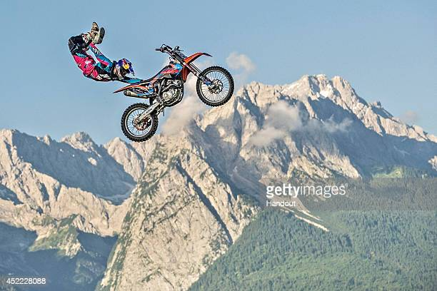 Luc Ackerman of Germany performs in front of the Zugspitze the highest mountain in Germany prior to the upcoming fourth stage of the Red Bull...