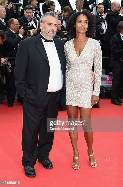 Luc Besson and Virginie Besson attend the 'Saint Laurent' Premiere at the 67th Annual Cannes Film Festival on May 17 2014 in Cannes France