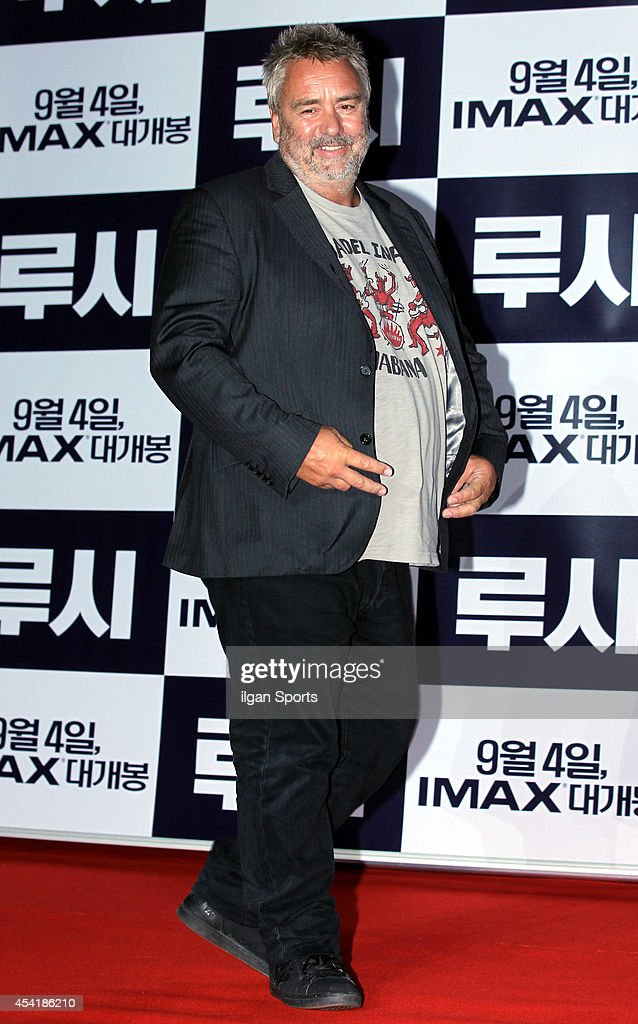 Luc Besson poses for photographs during the movie 'LUCY' red carpet event at IFC mall on August 20, 2014 in Seoul, South Korea.