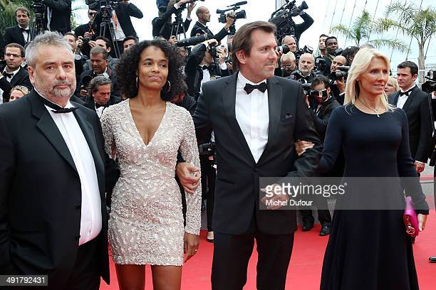 Luc Besson Virginie Besson Christophe Lambert and Marie Sara attend the Premiere of 'Saint Laurent' at the 67th Annual Cannes Film Festival on May 17...