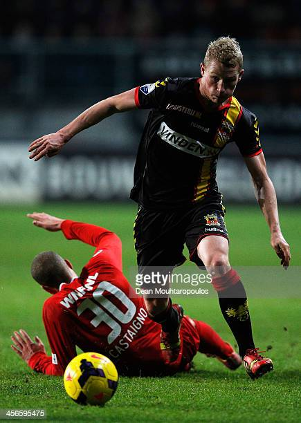 Luc Castaignos of Twente is beaten by Doke Schmidt of Go Ahead Eagles during the Eredivisie match between FC Twente and Go Ahead Eagles at De Grolsch...