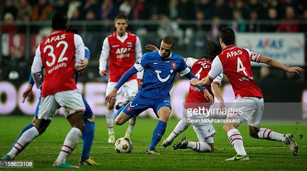 Luc Castaignos of Twente shoots on goal and Giliano Wijnaldum Etienne Reijnen and Nick Viergever of AZ look on during the Eredivisie match between AZ...