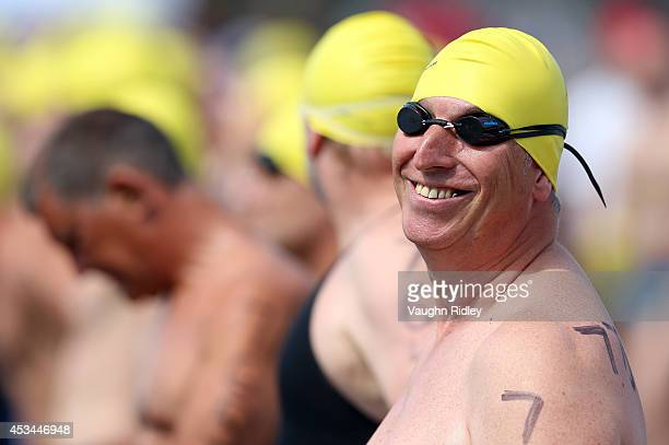 Luc Coelembier of France competes in the Men's 5054 Age Group 3km swim during the 15th FINA World Masters Championships at Parc JeanDrapeau on August...