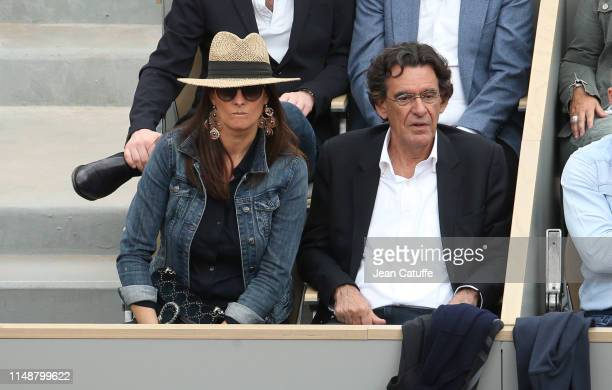 Luc Ferry and his wife MarieCaroline Becq Fouquieres attend the men's final during day 15 of the 2019 French Open at Roland Garros stadium on June 9...