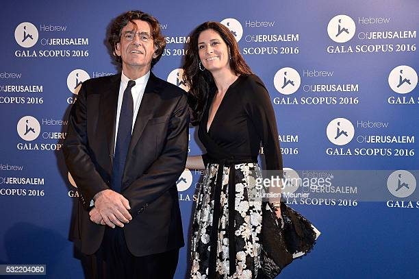 Luc Ferry and MarieCaroline Becq de Fouquieres attend the Scopus gala photocall at Pavillon Vendome on May 18 2016 in Paris France