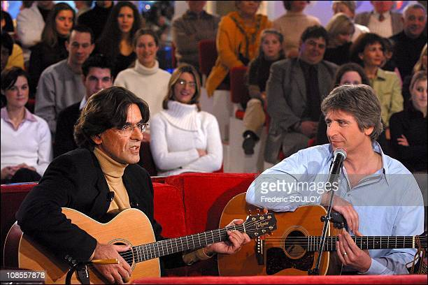 Luc Ferry of Yves Duteil in Paris France on January 08th 2003