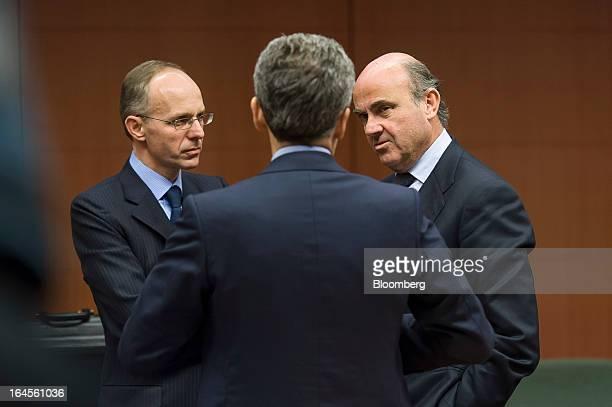 Luc Frieden Luxembourg's finance minister left Vittorio Grilli Italy's finance minister center and Luis de Guindos Jurado Spain's finance minister...